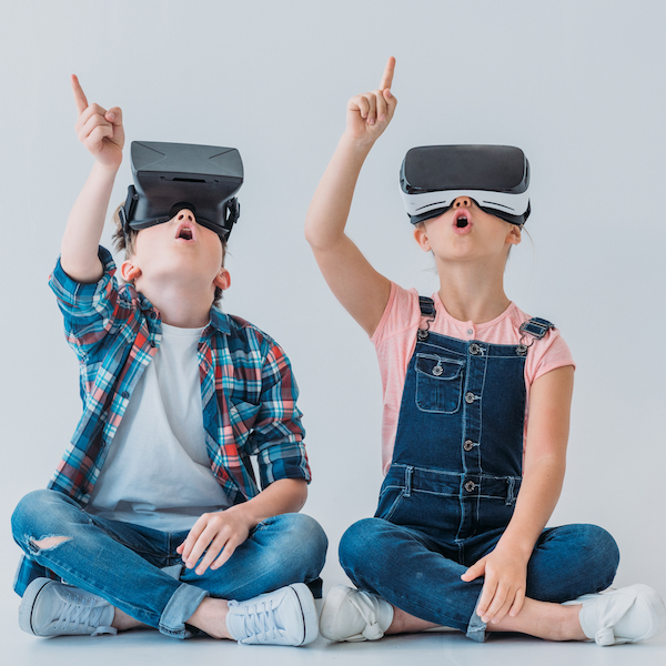 students pointing up wearing VR headsets