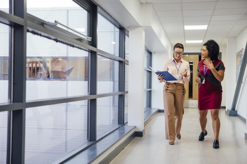 Teachers Walking Together